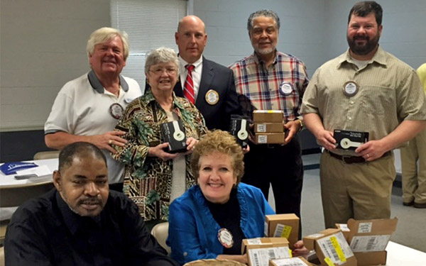 Bessemer Rotary Club members donate iPods to Oak Trace. Standing from left to right: Jim Wells, Diane Hyche, Neil Walker, Alphonso Patrick and Rob Kirkland. Seated  Oak Trace resident Leonard Hinton and Oak Trace Administrator Trina Vines.