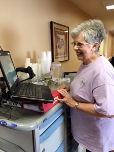 Licensed Practical Nurse Charlene Guest has spent her entire 48-year career at Hanceville Nursing & Rehab Center. In this photo, Ms. Guest prepares to update electronic medical records using a laptop connected to a medicine cart.