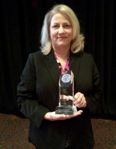 Cottage of the Shoals Administrator Cheryl Baker with the AHCA Silver Quality Award.