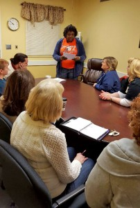 Oak Park Director of Nursing Amy Roberts, RN, shares information from a recent Alabama Nursing Home Association committee meeting with her staff.