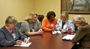 One of the daily department head meetings at Oak Park Nursing Home. From left to right: Assistant Director of Nursing Christy McDaniel, RN; Social Service Director Tracy Jenkins; Director of Nursing Amy Roberts, RN; MDS & Care Plan Coordinator LaGail Hodges, RN; and Business Office Manager Bonnie Carmack.