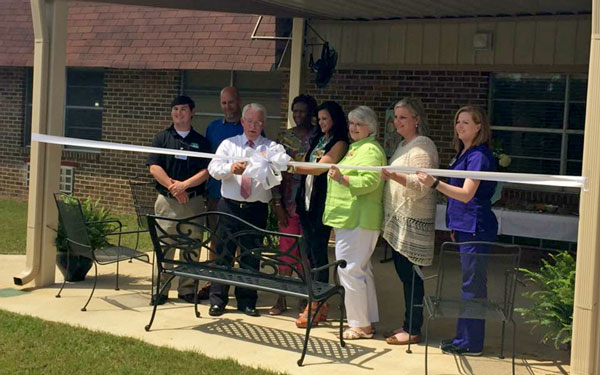 Aliceville Manor Nursing Home cuts the ribbon for Countryside Garden Memory Care Unit.