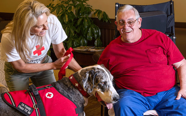 Mary Spencer and Stella visit with Stephen Sellers of Bill Nichols State Veterans Home. Photo courtesy of Kenneth Boone.