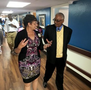 Fairview Health & Rehab Center Administrator Dianne Webb gives Jefferson County Commissioner George Bowman a tour of the Life Engagement Unit.