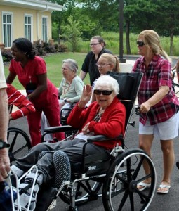 Resident LaVerne Harmon waves to the camera during move-in day at Regency Health Care & Rehab Center in Huntsville.