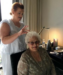 Katye Giddens of Crowne Health Care of Greenville styles Millie McDonald's hair and places her crown before the Ms. Alabama Nursing Home Pageant.