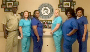 From left to right: Maintenance Director James Charleston, Director of Nursing Rhonda Lloyd, CNA Kimberly Mott, LPN Charge Nurse Dana Beck, CNA Tammy Cole and Restorative CNA Elaine Allen.
