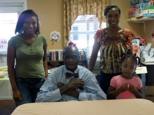 Roanoke Rehab & HealthCare Center resident John Murph with his daughter and grandchildren at the Celebration of Healing.