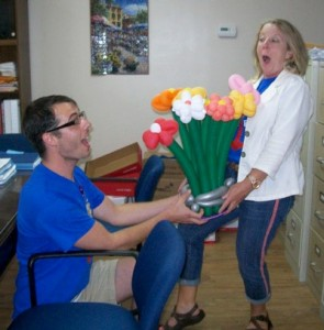 One employee presents another with a balloon bouquet at Cullman Health & Rehab Center.