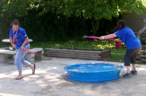 Cullman Health & Rehab Center employees take part in a water gun fight.