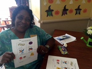 Oak Trace Housekeeping DIrector Martha Parham participates in fall prevention training.