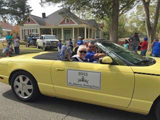 Ms. Alabama Nursing Home Sylvia Holland waves to the crowd while riding in the Christmas on the River Parade in Demopolis.