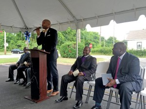 Magnolia Haven Administrator Travis Harper speaks at the ribbon cutting ceremony. Also pictured is Bishop Alvin Howard, left, and Kevin Ball of Ball HealthCare Services.