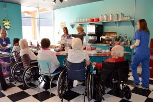 Residents surround the soda fountain at Bibb Medical Center Nursing Home's 50s Diner.